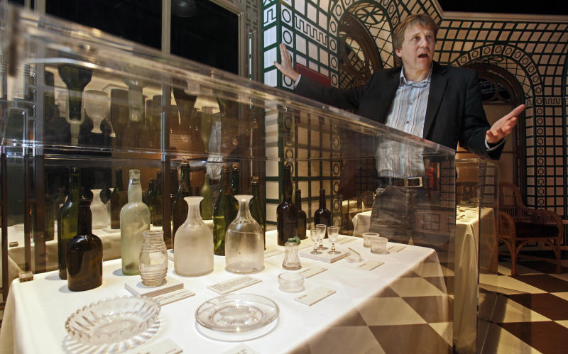 "FILE - John Zaller, creative director of Premier Exhibitions, discusses objects from the Titanic's Verandah Cafe on display in the ""Titanic: The Artifact Exhibition"" at the Discovery Times Square Exposition in New York,  in this June 24, 2009 file photo. The owner of the largest trove of artifacts salvaged from the Titanic is putting the vast collection up for auction as a single lot in 2012, the 100th anniversary of the world's most famous shipwreck. The auction is scheduled for April 1 by Guernsey's, a New York City auction house, according to filings by Premier Exhibitions Inc. with the Securities and Exchange Commission. A spokeswoman for the auction house and Premier Exhibitions declined Wednesday Dec. 28, 2011 to discuss the auction with The Associated Press until a formal announcement in January. (AP Photo/Richard Drew, File)"