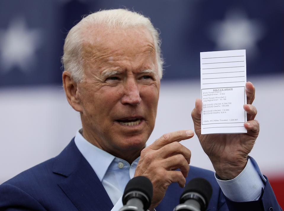 Democratic U.S. presidential nominee and former Vice President Joe Biden holds a copy of his schedule and notes as he delivers remarks during a campaign event in Warren, Michigan, U.S., September 9, 2020. REUTERS/Leah Millis     TPX IMAGES OF THE DAY