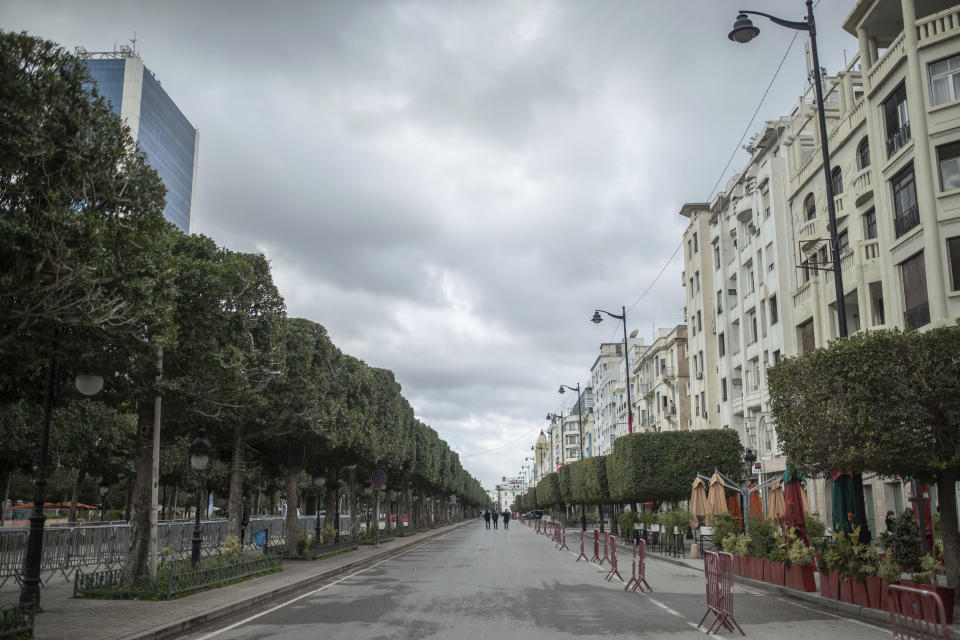 Tunis' landmark Avenue Habib Bourgiba, where massive protests took place in 2011, is empty on the tenth anniversary of the uprising, due to a national lockdown after a surge in COVID-19 cases, in Tunis, Thursday, Jan. 14, 2021. Tunisia is commemorating the 10th anniversary since the flight into exile of its iron-fisted leader, Zine El Abidine Ben Ali, pushed from power in a popular revolt that foreshadowed the so-called Arab Spring. But there will be no festive celebrations Thursday marking the revolution in this North African nation, ordered into lockdown to contain the coronavirus. (AP Photo/Mosa'ab Elshamy)