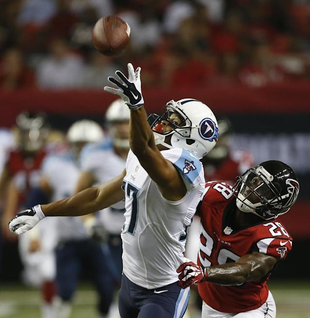 Tennessee Titans wide receiver Brian Robiskie (17) vies for a thrown ball as Atlanta Falcons cornerback Javier Arenas (28) defends during the second half of an NFL preseason football game, Saturday, Aug. 23, 2014, in Atlanta. (AP Photo/John Bazemore)