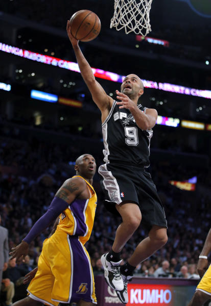 San Antonio Spurs' Tony Parker, of France, goes up for a basket as Los Angeles Lakers' Kobe Bryant, left, watches in the first half of an NBA basketball game in Los Angeles, Tuesday, Nov. 13, 2012. (AP Photo/Jae C. Hong)