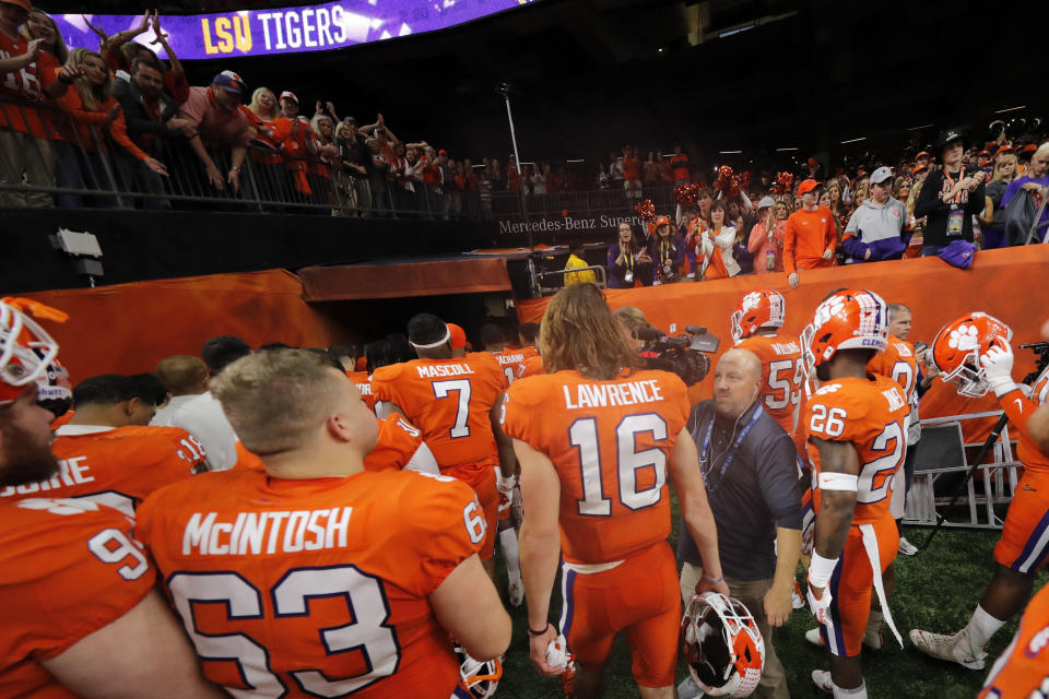 Clemson quarterback Trevor Lawrence (16) leaves the field after a NCAA College Football Playoff national championship game against LSU, Monday, Jan. 13, 2020, in New Orleans. LSU won 42-25. (AP Photo/Gerald Herbert)