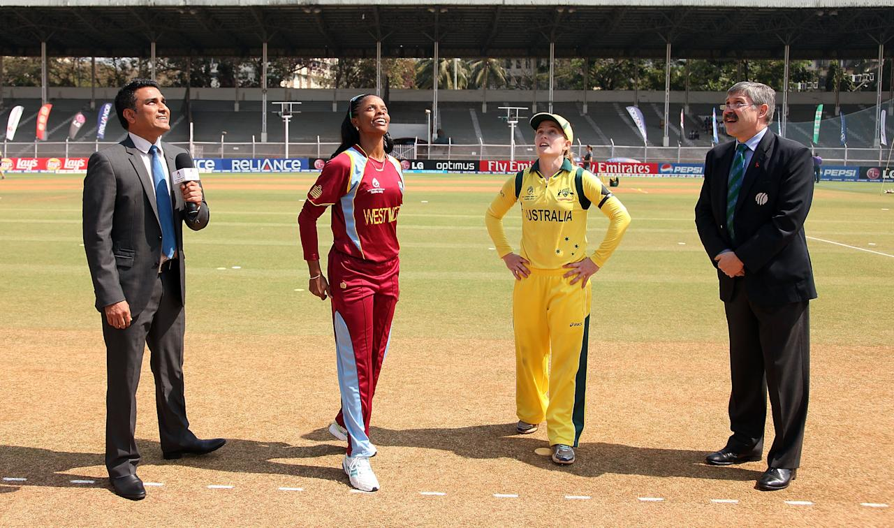 MUMBAI, INDIA - FEBRUARY 17: Sanjay Mandrekar, commentator,  Merissa Aguilleira, captain of West Indies, Jodie Fields captain of Australia and David Duke, match referee at the toss ahead of the final between Australia and West Indies of the Women's World Cup India 2013 played at the Cricket Club of India ground on February 17, 2013 in Mumbai, India. (Photo by Graham Crouch/ICC via Getty Images)