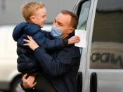 Tom Hayes reacts with his son Josh, after being released from HM Prison Ford, in Arundel