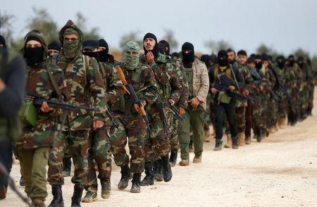 Turkey-backed Free Syrian Army fighters are seen at a training camp in Azaz