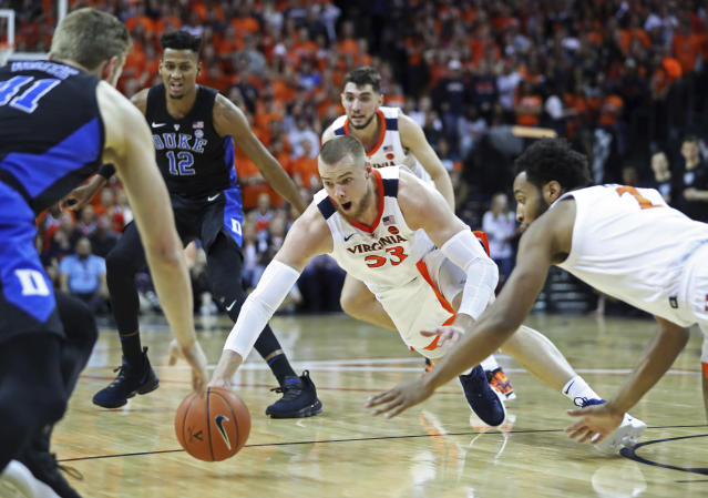 Virginia center Jack Salt (33) dives for a loose ball during the first half of the team's NCAA college basketball game against Duke on Saturday, Feb. 9, 2018, in Charlottesville, Va. (AP Photo/Zack Wajsgras)