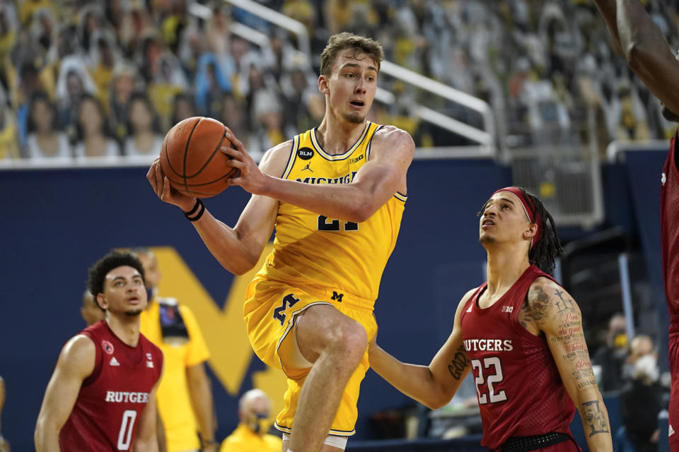 FILE - In this Feb. 18, 2021, file photo, Michigan guard Franz Wagner (21) drives on Rutgers guard Caleb McConnell (22) during an NCAA college basketball game in Ann Arbor, Mich. Wagner is a lottery prospect and one of the top forwards in the NBA draft. (AP Photo/Paul Sancya, File)