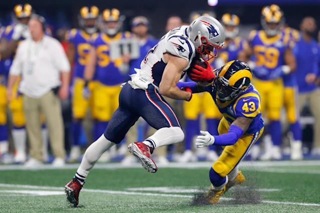 <p>John Johnson III #43 of the Los Angeles Rams tackles Julian Edelman #11 of the New England Patriots in the second half during Super Bowl LIII at Mercedes-Benz Stadium on February 3, 2019 in Atlanta, Georgia. (Photo by Kevin C. Cox/Getty Images </p>