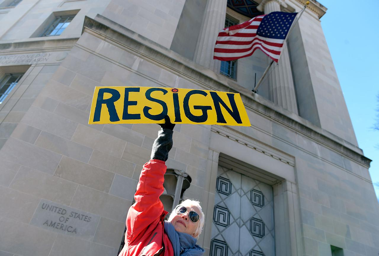 <p>Cheryl Kreiser of Silver Spring, Md. holds up a sign outside Justice Department in Washington, Thursday, March 2, 2017, as she joined a group to protest Attorney General Jeff Sessions. (AP Photo/Susan Walsh) </p>