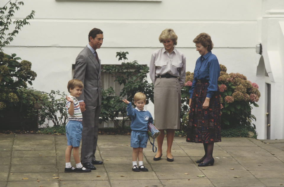 Prince Charles, Diana, Princess of Wales  (1961 - 1997) and Prince William attend Prince Harry's first day at Mrs Mynors' nursery school in London, September 1987. Headmistress Jane Mynors is on the right. (Photo by Jayne Fincher/Princess Diana Archive/Getty Images)