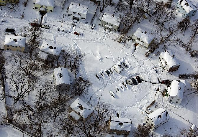 A neighborhood near New Haven, Conn., is buried in snow Sunday, Feb. 10, 2013, in the aftermath of a storm that hit Connecticut and much of New England Friday and early Saturday morning. (AP Photo/Craig Ruttle)