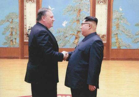 A U.S. government handout photo released by White House Press Secretary Sarah Huckabee Sanders shows U.S. Central Intelligence (CIA) Director Mike Pompeo meeting with North Korean leader Kim Jong Un in Pyongyang, North Korea in a photo that Sanders said was taken over Easter weekend 2018.  U.S. Government via REUTERS