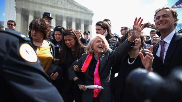 PHOTO: Edith Windsor, 83, is mobbed by journalists and supporters as she leaves the Supreme Court March 27, 2013 in Washington. (Chip Somodevilla/Getty Images)
