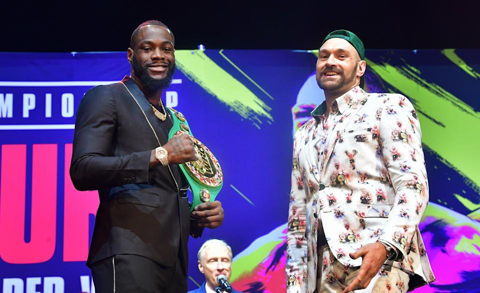 Boxers Deontay Wilder (L) and Tyson Fury (R) meet on stage during a press conference in Los Angeles, California on January 13, 2020 ahead of their re-match fight in Las Vegas on February 22. (Photo by Frederic J. BROWN / AFP) (Photo by FREDERIC J. BROWN/AFP via Getty Images)