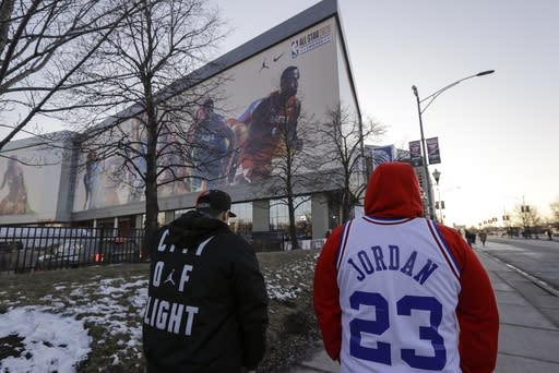 Fans make their way to the United Center for the NBA All-Star basketball game Sunday, Feb. 16, 2020, in Chicago. (AP Photo/Nam Huh)