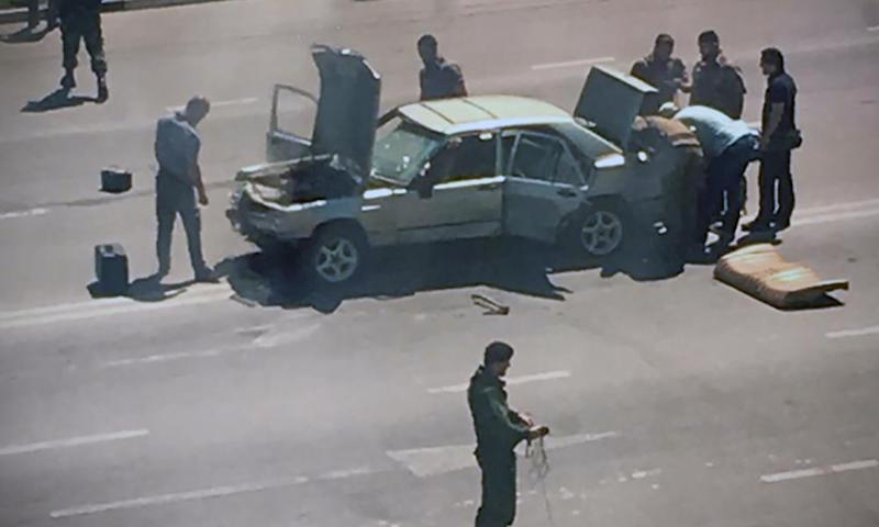 Chechen police officers working at the site of an attack in Grozny on Monday.