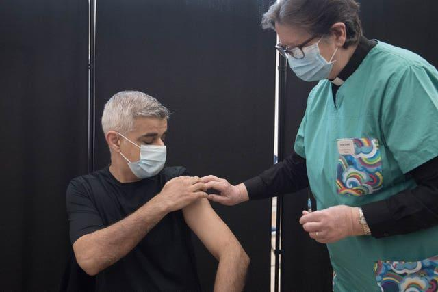 Mayor of London Sadiq Khan receives his first dose of the Pfizer vaccine from Dr Sue Clarke at a Covid-19 vaccination clinic at the Mitcham Lane Baptist Church, south London