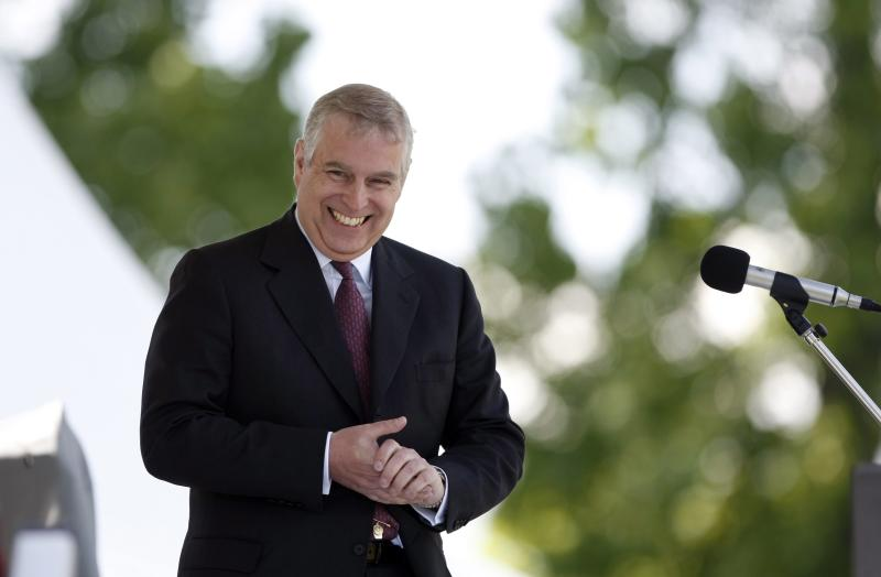 FILE - In a May 19, 2013 file photo, Prince Andrew, the Duke of York, honourary Chief of the Games for the 150th Victoria Highland Games Association, shares a laugh as he closes out the weekends events in Victoria. On Wednesday, Sept. 4, 2013, two days after an intruder was discovered prowling around Buckingham Palace, police confronted Prince Andrew, the second son of Queen Elizabeth II, in the royal residence's garden and demanded he identify himself. (AP Photo/The Candian Press, Chad Hipolito, File)