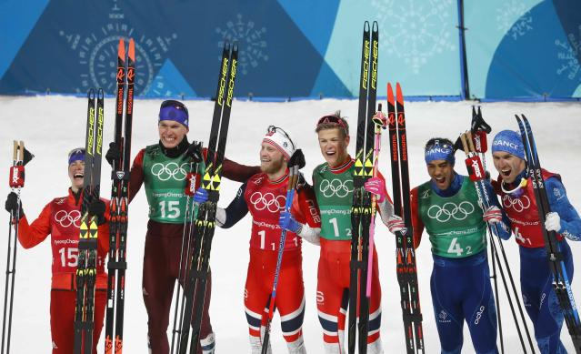 Cross-Country Skiing - Pyeongchang 2018 Winter Olympics - Men's Team Sprint Free Finals - Alpensia Cross-Country Skiing Centre - Pyeongchang, South Korea - February 21, 2018. Johannes Hoesflot Klaebo and Martin Johnsrud Sundby of Norway celebrate winning gold with athletes from Russia and France . REUTERS/Kai Pfaffenbach