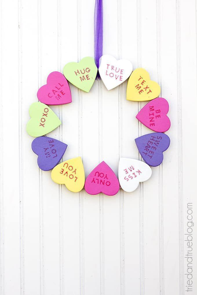 """<p>Sweeten up your home in February with this charming wreath that replicates everyone's favorite Valentine's candy.</p><p><strong>Get the tutorial at <a href=""""https://www.triedandtrueblog.com/candy-hearts-valentines-day-wreath/"""" rel=""""nofollow noopener"""" target=""""_blank"""" data-ylk=""""slk:Tried and True"""" class=""""link rapid-noclick-resp"""">Tried and True</a>. </strong></p><p><strong><a class=""""link rapid-noclick-resp"""" href=""""https://www.amazon.com/DecoArt-Crafters-Acrylic-Paint-2-Ounce/dp/B007WUMZGI/ref=as_li_ss_tl?tag=syn-yahoo-20&ascsubtag=%5Bartid%7C10050.g.35057743%5Bsrc%7Cyahoo-us"""" rel=""""nofollow noopener"""" target=""""_blank"""" data-ylk=""""slk:SHOP DECOART PAINT"""">SHOP DECOART PAINT </a><br></strong></p>"""