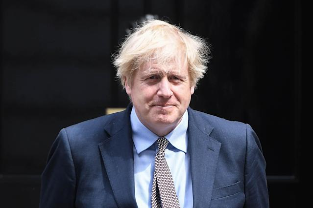 British Prime Minister Boris Johnson is seen outside Number 10 Downing Street on May 8, 2020 in London, United Kingdom.The UK commemorates the 75th Anniversary of Victory in Europe Day (VE Day) with a pared-back rota of events due to the coronavirus lockdown. On May 8th, 1945 the Allied Forces of World War II celebrated the formal acceptance of surrender of Nazi Germany. (Photo by Peter Summers/Getty Images)