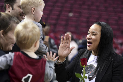 South Carolina coach Dawn Staley, right, cerebrates a win with fans after an NCAA college basketball game against Auburn, Thursday, Feb. 13, 2020, in Columbia, S.C. (AP Photo/Sean Rayford)
