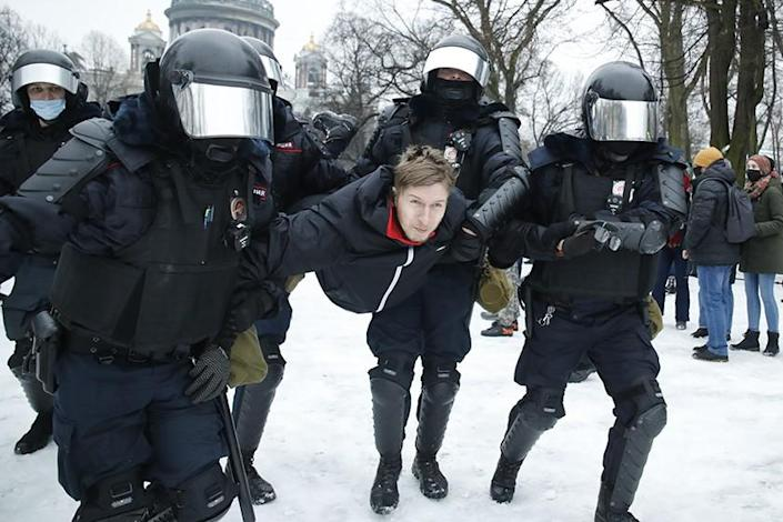 A man is detained in St. Petersburg, Russia, on Saturday during a protest against the jailing of opposition leader Alexei Navalny.