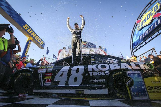 Jimmie Johnson celebrates in Victory Lane after winning the NASCAR Sprint Cup Series auto race Sunday, Sept. 29, 2013, in Dover, Del. (AP Photo/The News-Journal, Suchat Pederson)