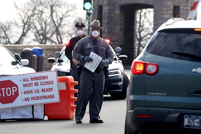 Police officers direct drivers as they enter Glen Island Park in New Rochelle, N.Y March 22, 2020. The park was the first site set in Westchester County set up for Covid-19 testing. New Rochelle was the epicenter of the spread of the Covid-19 virus after congregants of a neighborhood synagogue were the first to be diagnosed with the virus.