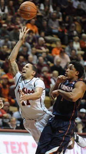 Virginia's Jontel Evans (1) defends against Virginia Tech's Erik Green as he shoots during the second half of an NCAA college basketball game Tuesday, Feb. 21, 2012, at Cassell Coliseum in Blacksburg, Va. Virginia won 61-59. (AP Photo/Don Petersen)