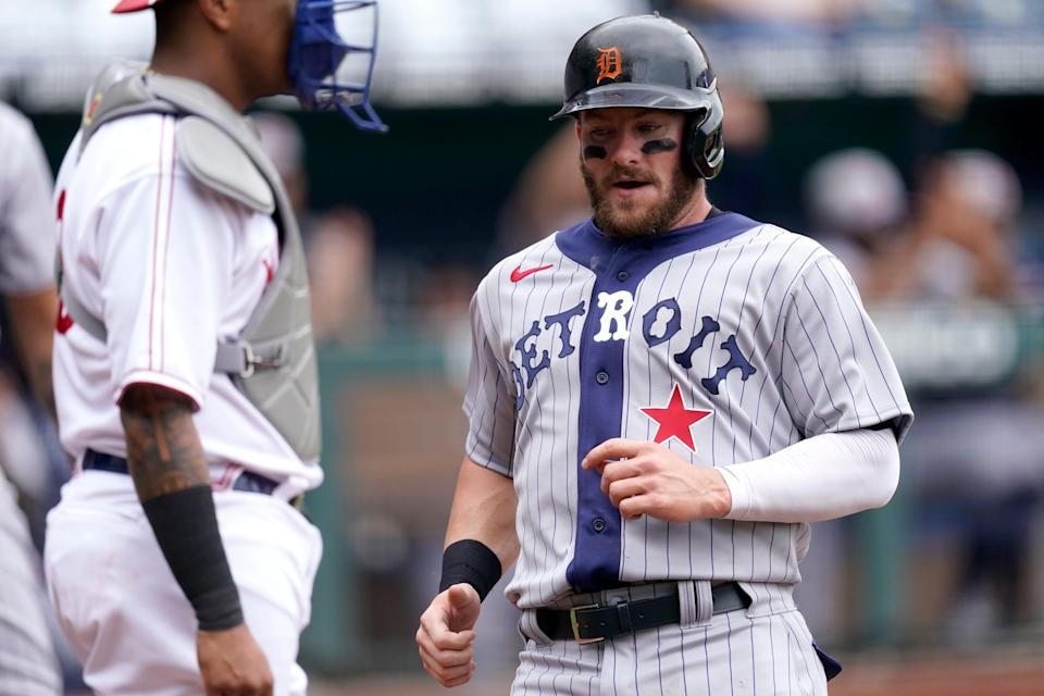 Detroit Tigers' Robbie Grossman runs home to score on an RBI single by Jeimer Candelario during the first inning of a baseball game Sunday, May 23, 2021, in Kansas City, Mo.