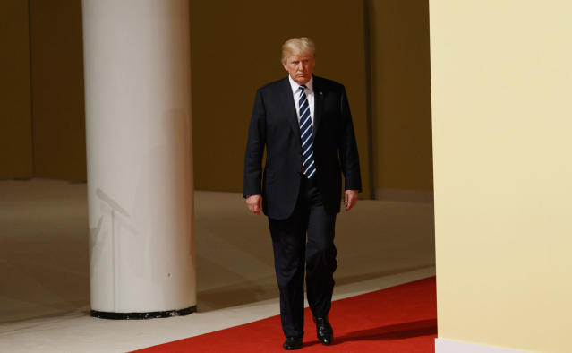 <p>President Donald Trump walks to meet with German Chancellor Angela Merkel after arriving at the G20 Summit, Friday, July 7, 2017, in Hamburg, Germany. Merkel is welcoming leaders of the Group of 20 global economic powers to a two-day summit in Hamburg. The meeting at the city's trade fair center opens Friday with a discussion on fighting terrorism — one of the least contentious subjects on an agenda that also includes global trade and climate. (Photo: Evan Vucci/AP) </p>