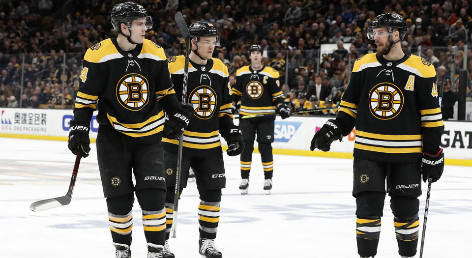 BOSTON, MA - APRIL 11: Boston Bruins center David Krejci (46) instructs Boston Bruins left wing Jake DeBrusk (74) and Boston Bruins center Karson Kuhlman (83) during Game 1 of the First Round between the Boston Bruins and the Toronto Maple Leafs on April 11, 2019, at TD Garden in Boston, Massachusetts. (Photo by Fred Kfoury III/Icon Sportswire via Getty Images)