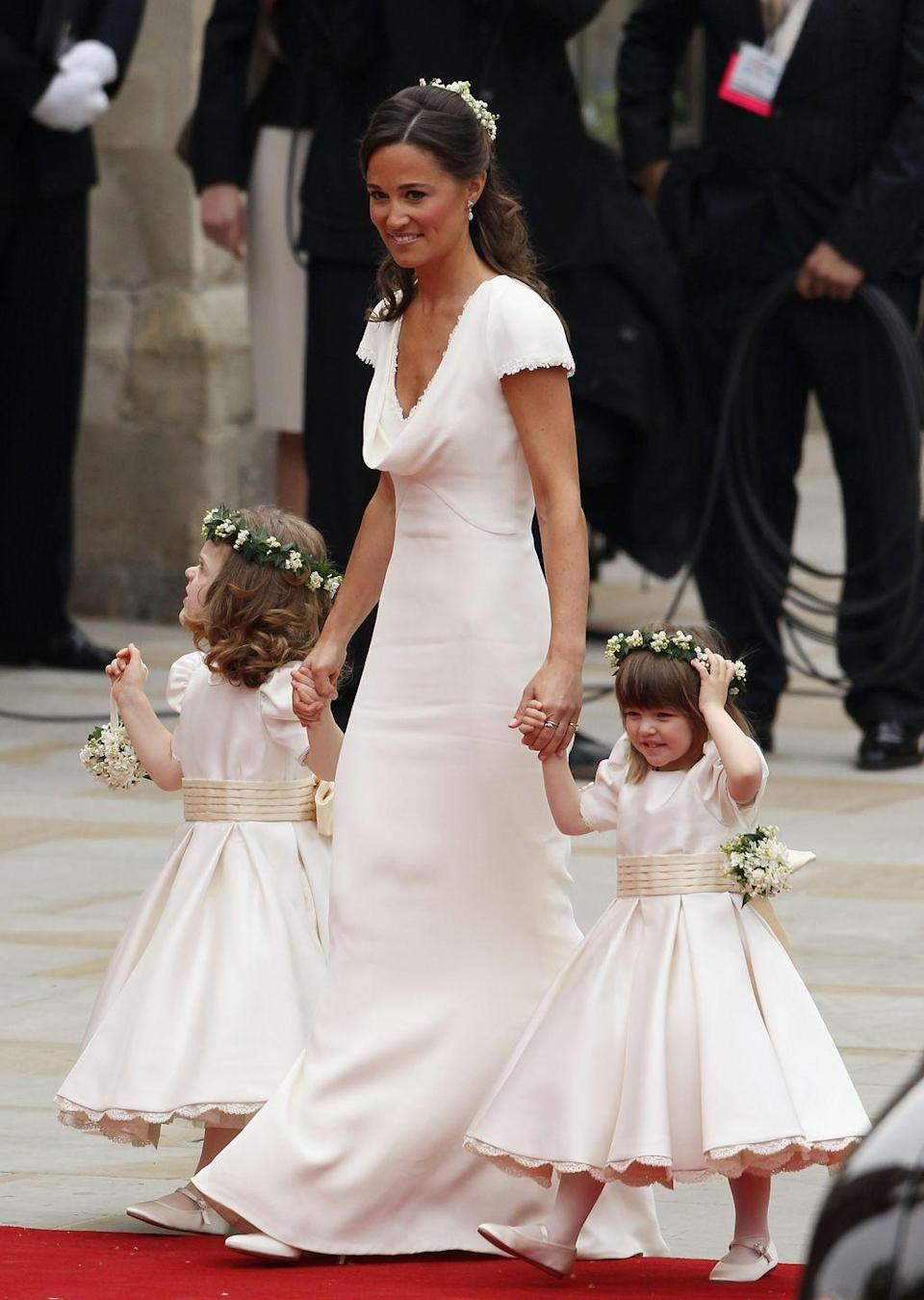 """<p>Her sister Pippa Middleton assisted with the nine-foot train and helped wrangle members of her bridal party. When <a href=""""https://www.goodhousekeeping.com/life/a20687056/pippa-middleton-husband-james-matthews/"""" rel=""""nofollow noopener"""" target=""""_blank"""" data-ylk=""""slk:Pippa married James Matthews"""" class=""""link rapid-noclick-resp"""">Pippa married James Matthews</a> last year, the Duchess of Cambridge didn't serve as hers (she reportedly didn't want to detract attention from the bride!), but she did return the favor of keeping unruly page boy Prince George and flower girl <a href=""""https://www.goodhousekeeping.com/life/a19981218/princess-charlotte-age-birth/"""" rel=""""nofollow noopener"""" target=""""_blank"""" data-ylk=""""slk:Princess Charlotte"""" class=""""link rapid-noclick-resp"""">Princess Charlotte</a> in check. </p>"""