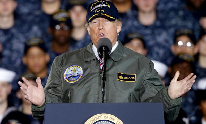 Donald Trump with Navy and shipyard personnel aboard nuclear aircraft carrier Gerald R Ford