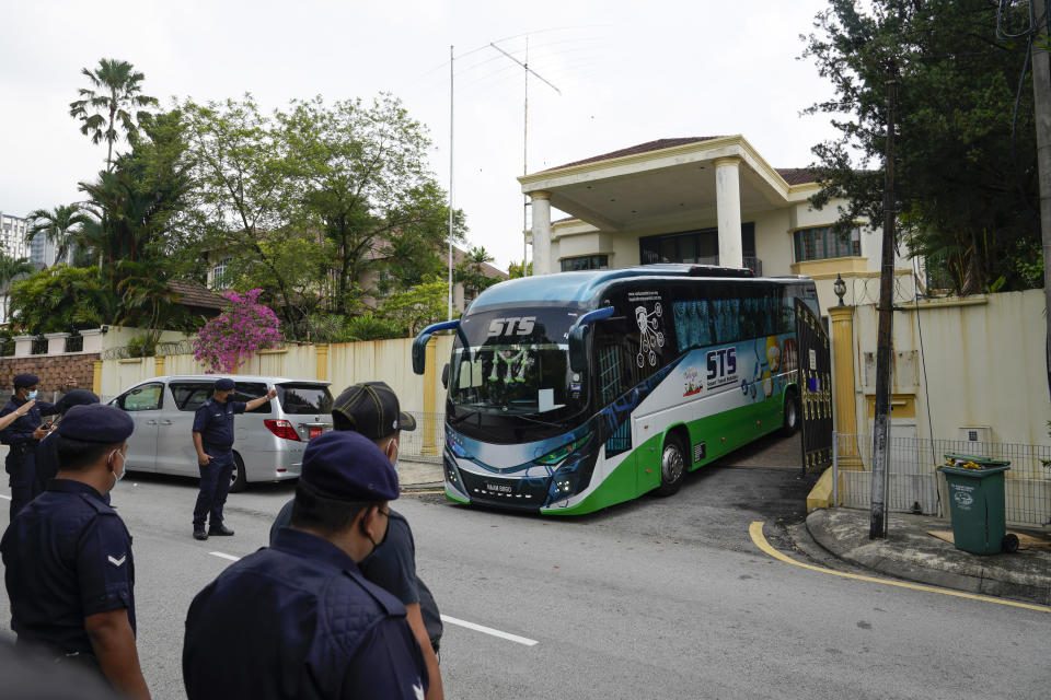 A bus carrying staffs of the North Korean embassy leaves the embassy compound in Kuala Lumpur, Sunday, March 21, 2021. Malaysia on Friday ordered all North Korean diplomats to leave the country within 48 hours, an escalation of a diplomatic spat over Malaysia's move to extradite a North Korean suspect to the United States on money laundering charges. (AP Photo/Vincent Thian)