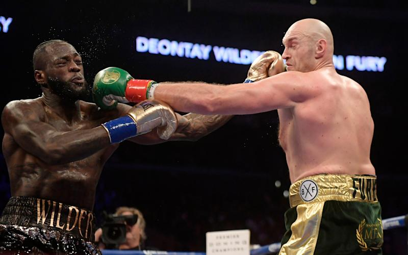 Wilder and Fury are set to meet again in February - AP