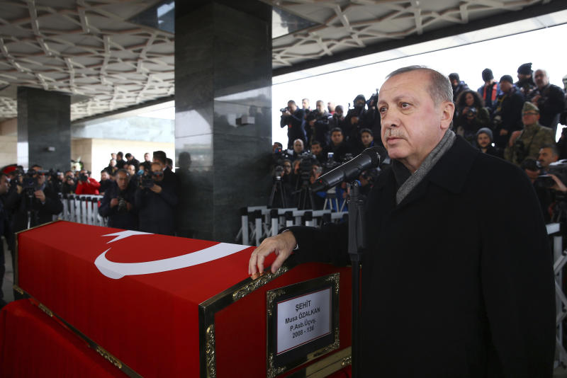 FILE - In this Tuesday, Jan. 23, 2018 file photo, Turkey's President Recep Tayyip Erdogan speaks during the funeral prayers for Sergeant Musa Ozalkan, the first Turkish soldier to be killed in Turkey's cross-border operation on Afrin, a Kurdish held enclave in northern Syria, in Ankara, Turkey. Turkish officials have been threatening to launch the offensive and preparing for it for months. But there have been shades of gray in Ankara's professed goals about the military incursion, which was launched on Saturday. (Kayhan Ozer/Pool Photo via AP, FILE)