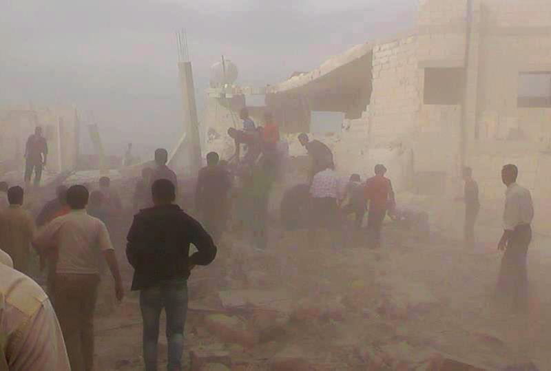 In this Wednesday, Oct. 17, 2012 photo, citizen journalism image provided by Edlib News Network, ENN, which has been authenticated based on its contents and other AP reporting, Syrians rescue people from under the rubble of a destroyed building that was attacked by a Syrian force airstrike, at Kfar Nebel town, in Idlib province, northern Syria. (AP Photo/Idlib News Network ENN)