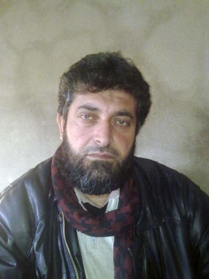 In this undated photo provided by the Falcons of Damascus Brigade, Syrian rebel commander Ahmed Eissa al-Sheikh poses for a portrait. Al-Sheikh is one face of the rebel movement in Syria. During two weeks with rebels in northern Syria, three Associated Press journalists found more than 20 rebel groups who often destroy government army posts and convoys but lack the weapons and unity to do more than gradually chip away at the regime of President Bashar Assad _ a recipe for a long, bloody insurgency.(AP Photo/Ahmed al-Assi, Falcons of Damascus Brigade)