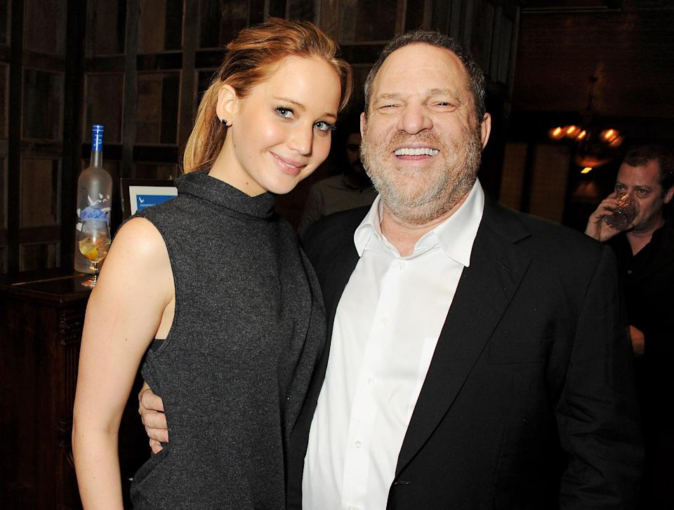 Jennifer Lawrence, pictured with Harvey Weinstein at a party for <em>Silver Linings Playbook</em> in 2013, denies any intimate relationship with the disgraced producer. (Photo: David M. Benett/Getty Images)