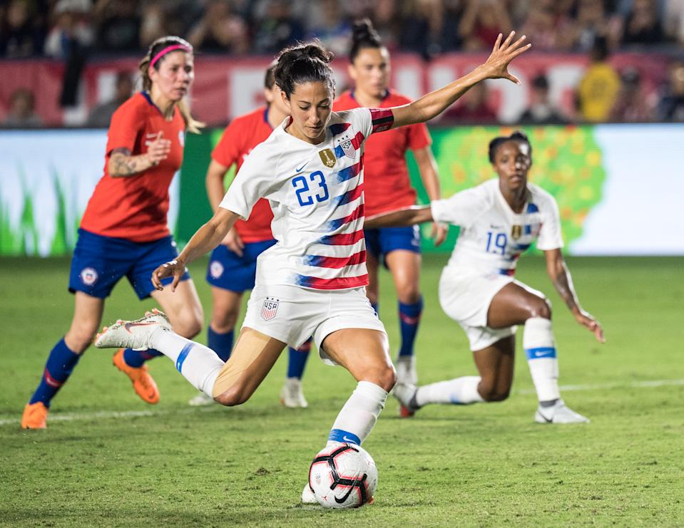 CARSON, CA - AUGUST 31:   Christen Press #23 of United States shoots a penalty kick as Crystal Dunn #19 of United States during the United States international friendly match against Chile at StubHub Center on August 31, 2018 in Carson, California.  The United States won the match 3-0  (Photo by Shaun Clark/Getty Images)