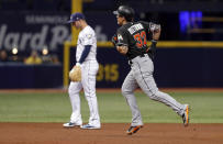 Miami Marlins' Derek Dietrich rounds the bases after his solo home run, past Tampa Bay Rays third baseman Daniel Robertson during the third inning of a baseball game Friday, July 20, 2018, in St. Petersburg, Fla. (AP Photo/Mike Carlson)