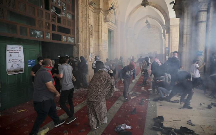Palestinians clash with Israeli security forces at the Al Aqsa Mosque compound in Jerusalem's Old City Monday, May 10, 2021 - AP/Mahmoud Illean