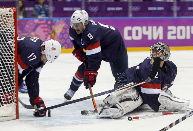 USA goaltender Jonathan Quick blocks a shot on goal by Finland as forward Ryan Kesler seals off the edge of the net during the first period of the men's bronze medal ice hockey game at the 2014 Winter Olympics, Saturday, Feb. 22, 2014, in Sochi, Russia. (AP Photo/Petr David Josek)
