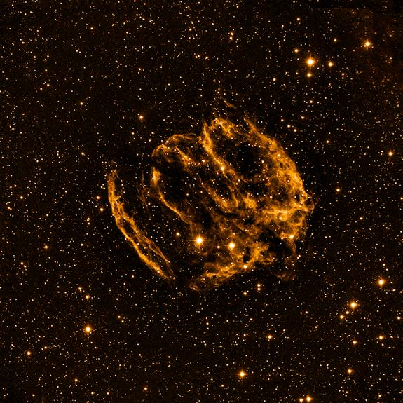 An optical view of the rare supernova remnant W49B, which may be the home of the youngest black hole in the Milky Way Galaxy. Image released Feb. 13, 2013.