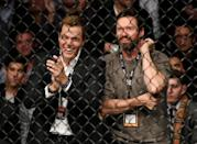 <p>Actor Hugh Jackman (R) watches as Stephen Thompson and Tyron Woodley fight in their welterweight championship bout during the UFC 205 event at Madison Square Garden on November 12, 2016 in New York City. (Photo by Jeff Bottari/Zuffa LLC/Zuffa LLC via Getty Images) </p>