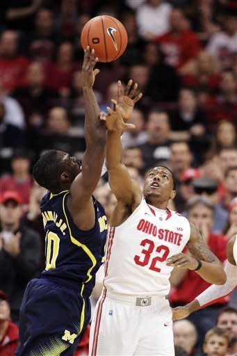 Ohio State's Lenzelle Smith Jr., (32) blocks a shot by Michigan's Tim Hardaway Jr., (10) during the first half of an NCAA college basketball game, Sunday, Jan. 13, 2013, in Columbus, Ohio. (AP Photo/Mike Munden)