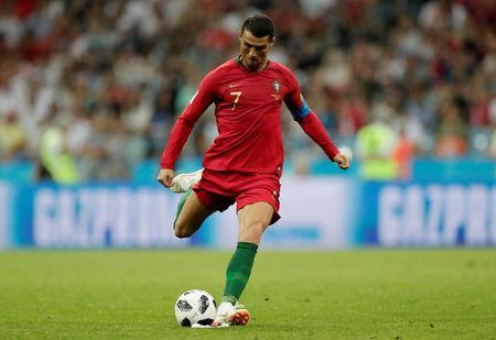 Soccer Football - World Cup - Group B - Portugal vs Spain - Fisht Stadium, Sochi, Russia - June 15, 2018 Portugal's Cristiano Ronaldo scores their third goal from a free kick to complete his hat-trick REUTERS/Ueslei Marcelino
