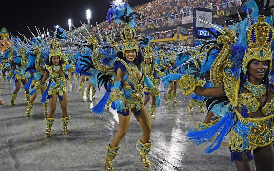 Members of Vila Isabel samba school perform during the last night of Rio's Carnival parade in February of this year - CARL DE SOUZA /AFP